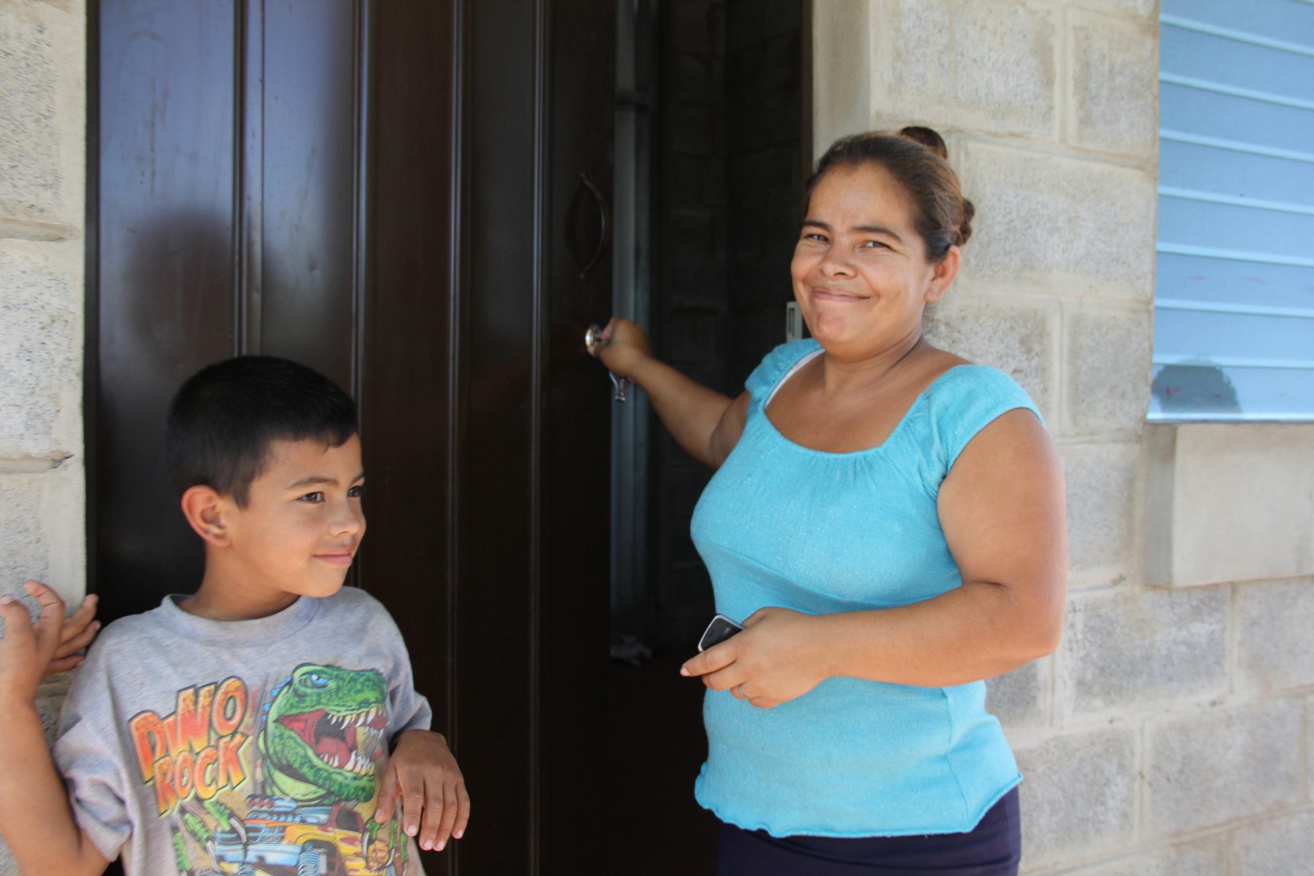 Gregoria unlocking the door to her new home